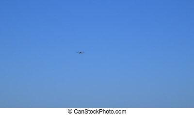 An aeroplane soaring through the sky - A tracking long shot...