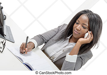 african american business woman smiling on phone