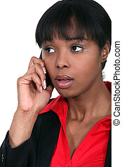An African American businesswoman getting bad news.