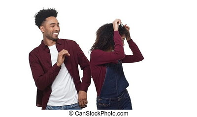 An African American couple dance on white isolated studio screen