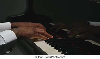 An African American man with two hands plays gentle ...