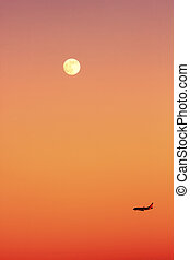 An aircraft at sunset