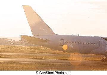 an airplane at an runway sun theme