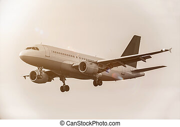 an airplane in the sky with sepia color