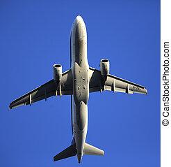 An airplane seen from below landing.