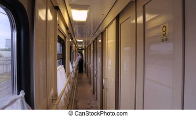 An aisle in a moving train
