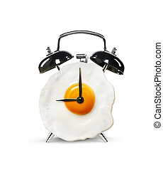 An alarm clock in the form of an egg isolated on a white ...