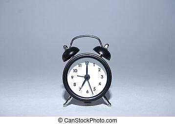 alarm clock - an alarm clock on grey background