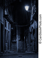 An alley by night