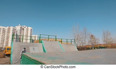 An alone bmx rider in the skatepark. Mid shot