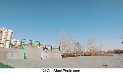 An alone bmx rider on ramps in the skatepark. Mid shot