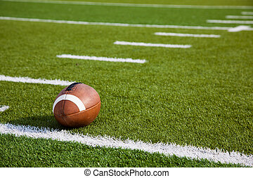An American football on field