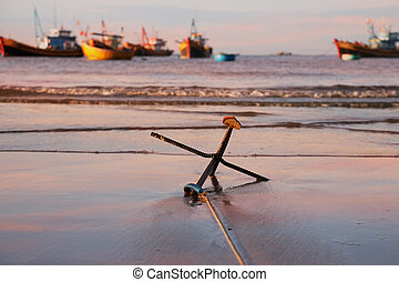 An anchor on the beach