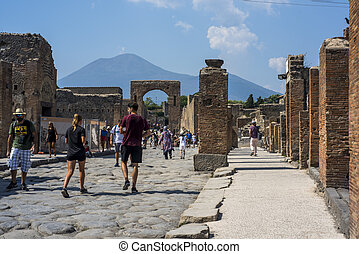 An ancient cobbled street in the ruins of Pompeii, Italy, 2019.