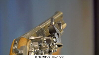 An ancient revolver gun with gold details