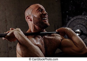 angry bodybuiler can't lift the barbell over the head
