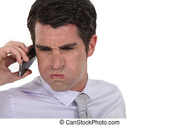 An angry businessman over the phone.