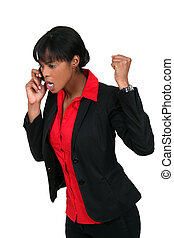 An angry businesswoman over the phone.