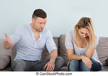 Man Looking At His Depressed Wife