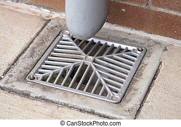 drain - an angular water drain in an industrial building