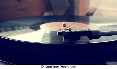 An antiquarian record player with the needle playing record...