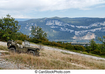 antique military vehicle in the mountain