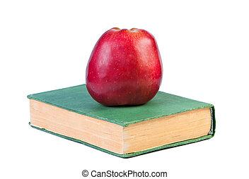 An apple on a book.