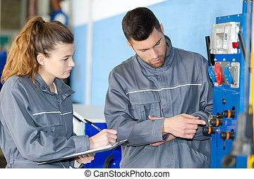 an apprentice working on machine