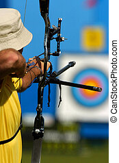 An archer takes aim at a target during competiton.