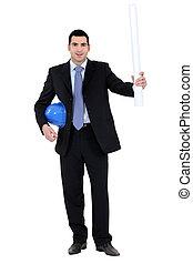 An architect holding blueprints