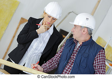 an architect is thinking in front of blueprint