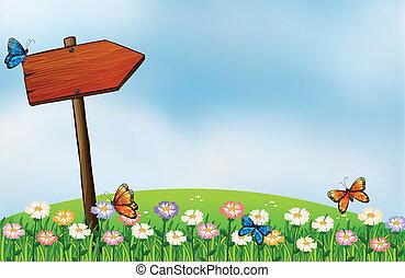 An arrow signboard and the butterflies