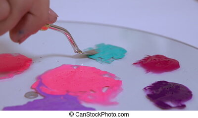An artist is filling the palette