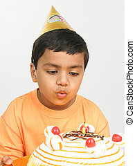 kid blowing the candle
