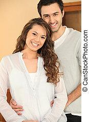 an Asian woman and a caucasian man