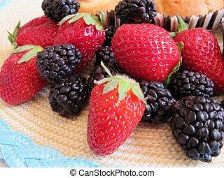 An assortment of berries; fresh, ripe strawberries and blackberries