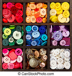 an assortment of buttons arranged by color
