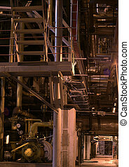 an assortment of different size and shaped pipes at a power plant