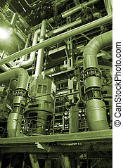 an assortment of different size and shaped pipes at a power plant.