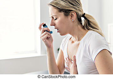 An Asthmatic using her inhaler because of breath difficulties