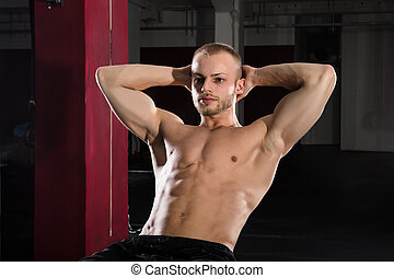 An Athlete Man Doing Stretching Exercise