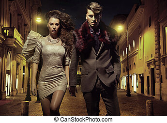 An attractive couple walking downtown