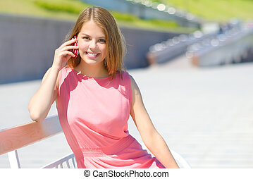An attractive girl talking on the cell phone