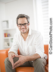 attractive man smiling on a couch