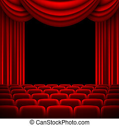 an auditorium with a red curtain