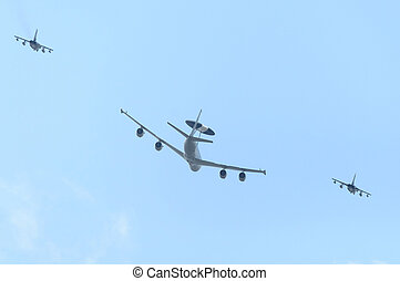 An AWACS and two jet fighters
