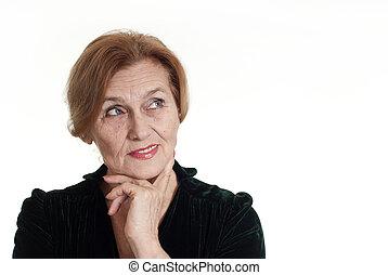 an beautiful elderly woman in a dress standing