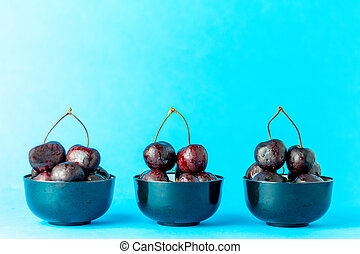 Cherries on a blue background. Concept of healthy food and fruit.