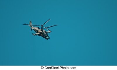 An combat green camouflage coloring helicopter flying down. Mid shot