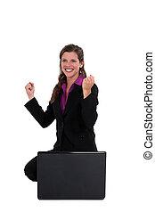 An ecstatic businesswoman.